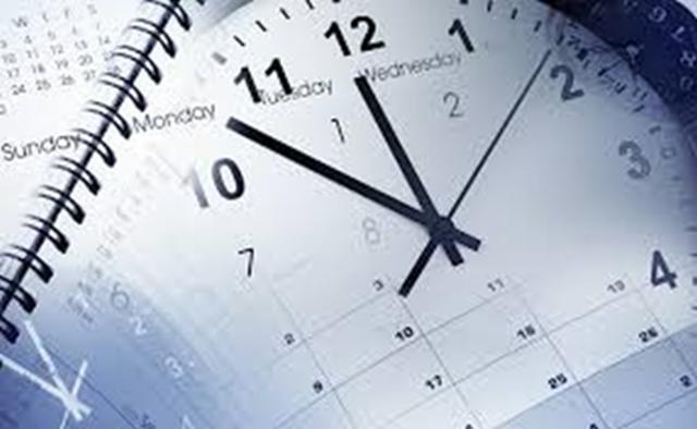 時計とカレンダーで時間が経過するのを表しています。